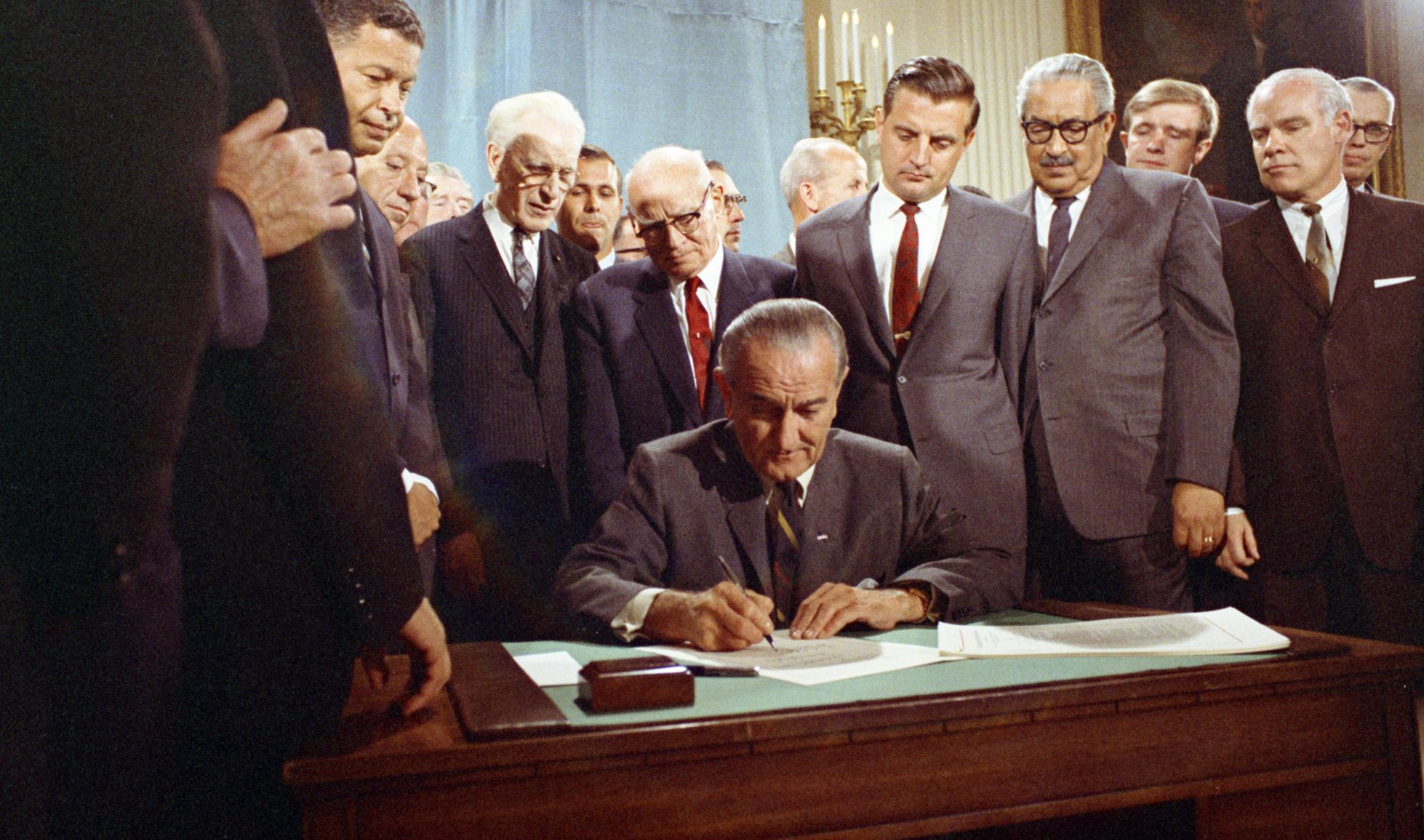 Photo of the signing of the Civil Rights Act of 1968. Video from the LBJ Library of the signing of the 1968 Civil Rights Act