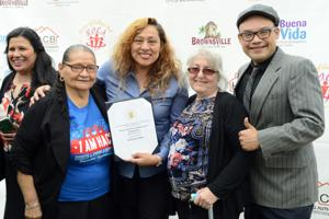 [U.S. Department of Housing and Urban Development EnVision Center Program Manager Unabyrd Wadhams reads from a certificate that designates Buena Vida Choice Neighborhood Headquarters in Brownsville an official EnVision Center Wednesday morning from the downtown Brownsville headquarters.]