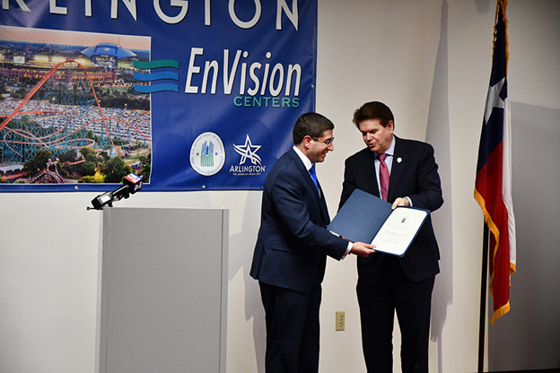 [Arlington Mayor Jeff Williams hands a proclamation to HUD Assistant Deputy Secretary for Field Policy and Management Benjamin DeMarzo. (City of Arlington photo)]