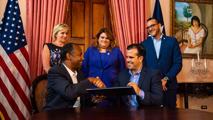 [Sitting with Secretary Carson are Puerto Rico Governor Ricardo Rosselló. Standing L-R:  HUD Deputy Secretary Pam Patenaude, Congresswoman Jenniffer González and Puerto Rico Secretary of Housing Fernando Gil]. HUD Photo