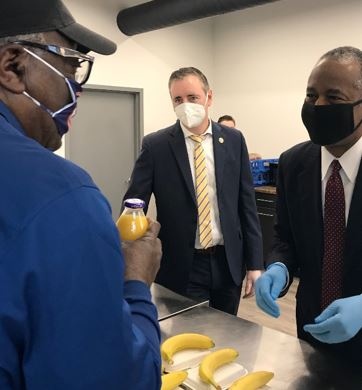 [Secretary Carson serving breakfast to veteran tenants at the Edison 64 Veterans Community]