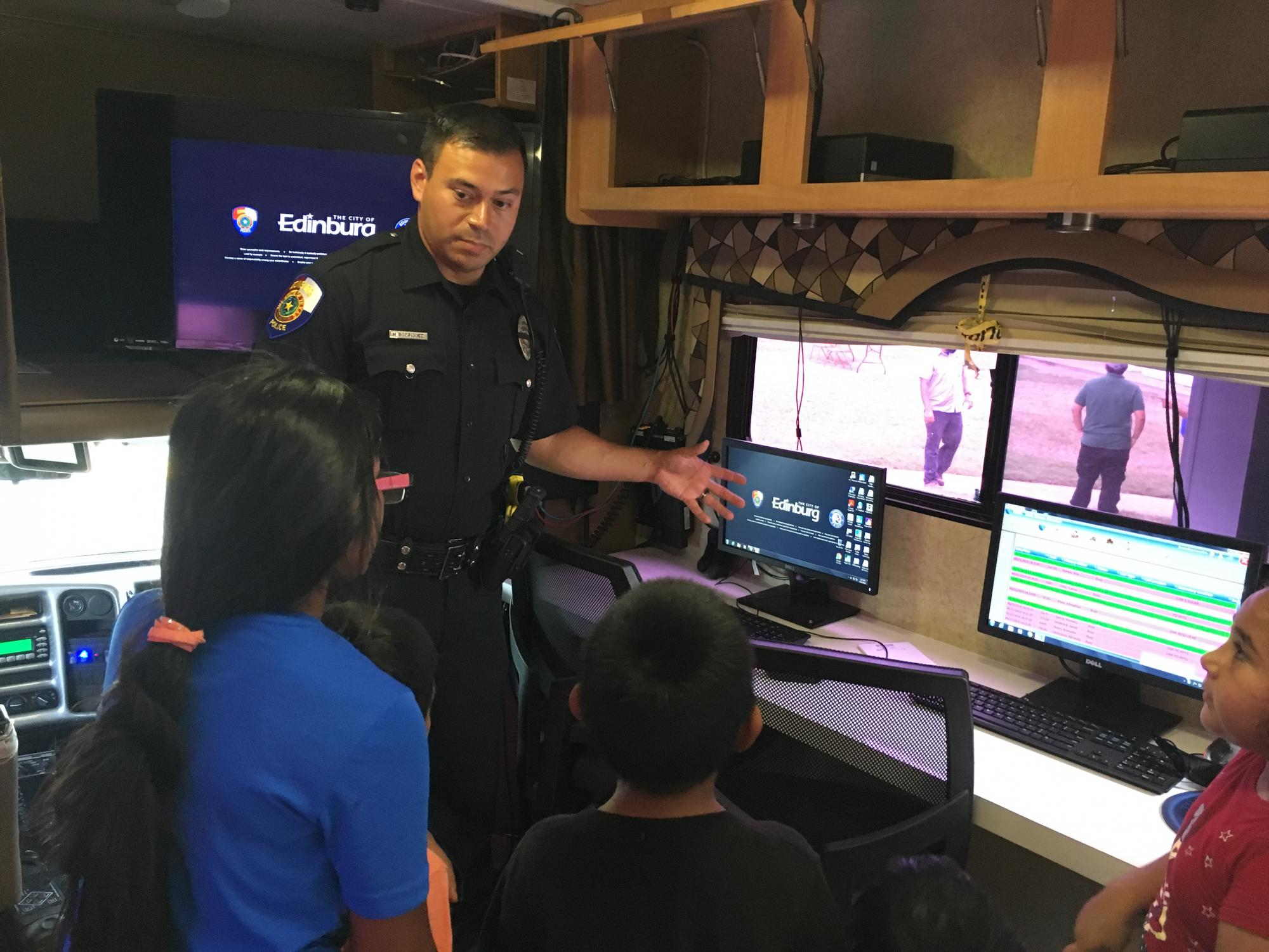 Police Officer teaches the importance of safety, Edinburg, TX.. HUD Photo