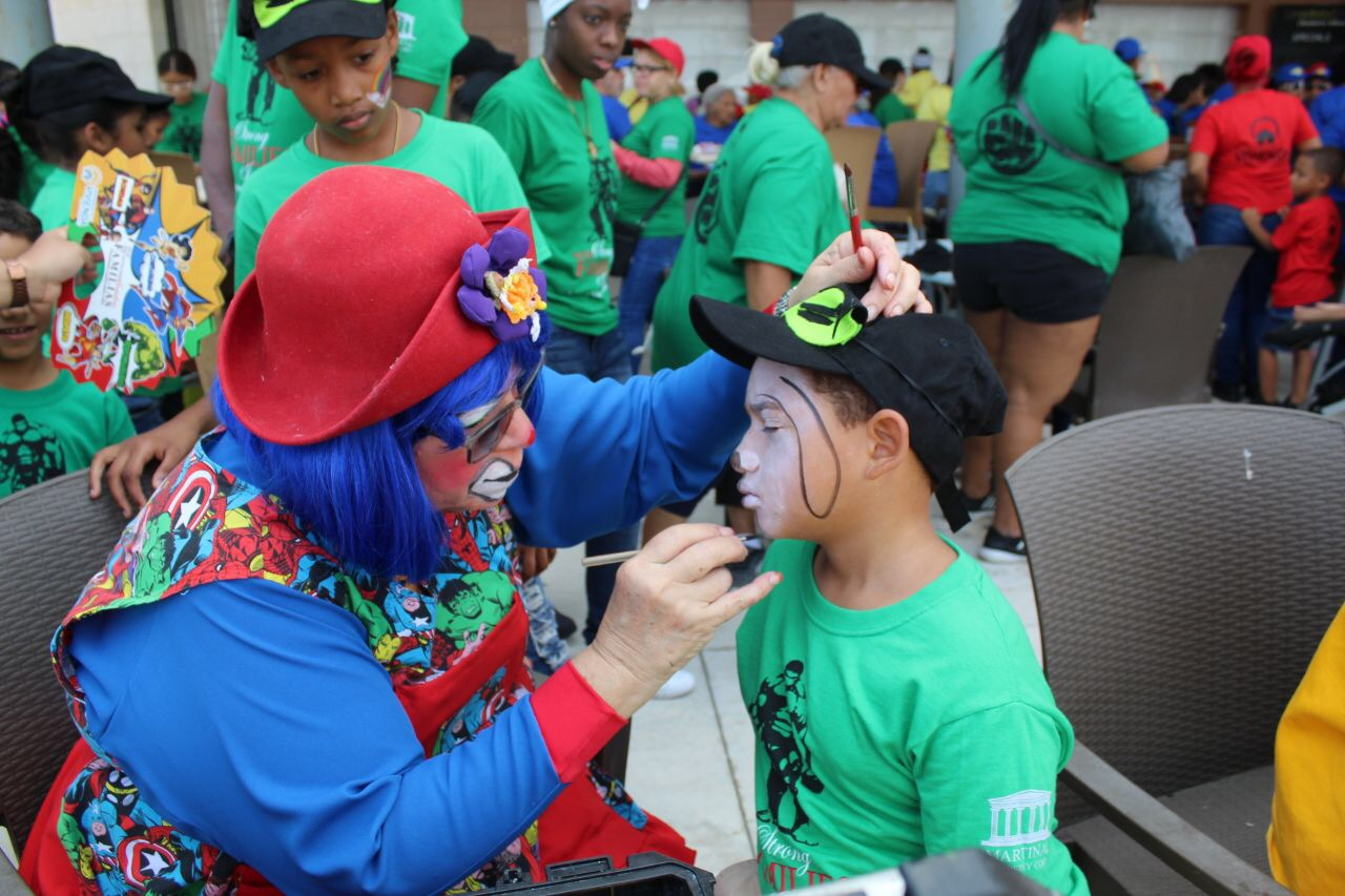 Participant Enjoys Face Painting during Puerto Rico's Event. HUD Photo
