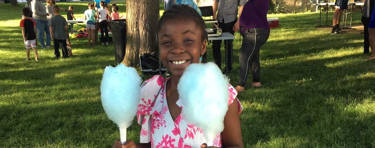 Participant enjoys cotton candy treat during Medford Housing Authority event in Medford, MA. HUD Photo