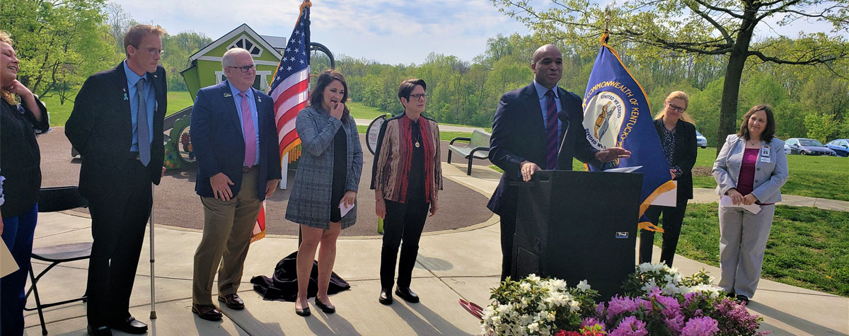 [Partners and Veterans gather at Veterans Park in Lexington to celebrate the end to Veteran homelessness].