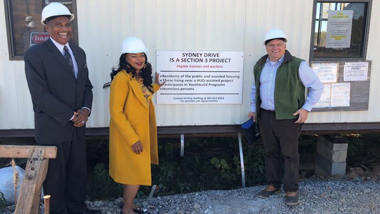 [HUD Southeast Regional Administrator Denise Cleveland-Leggett joins Housing Authority of the Birmingham District Executive Director Michael Lundy (left), and Wen Yerby, President of Hollyhand Development Company for a visit to visit to Sidney Drive, a Section 3 Project.]. HUD Photo