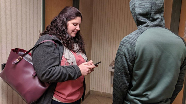 Melissa Izinga conducts the CT Youth Count survey using the special app for smart phones. HUD Photo