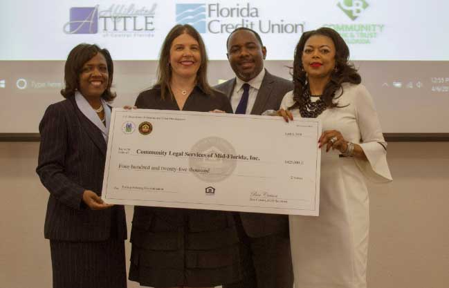 [Community Legal Services of Mid Florida Attorney Kimberly Sanchez received the ceremonial check presented by HUD Southeast Regional Administrator Denise Cleveland-Leggett.]. HUD Photo