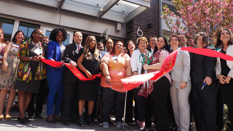 [Regional Administrator Patton joins state and city officials to cut the the ribbon at 603 Mother Gaston Blvd supportive housing complex]. HUD Photo