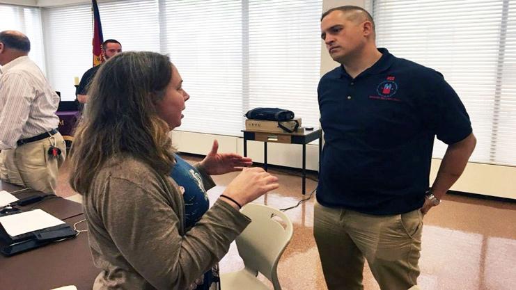 [Administrator Joe DeFelice speaks with Committee member]. HUD Photo