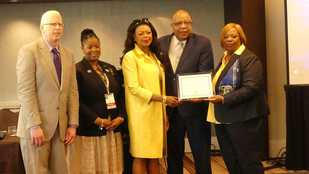 [John Benison, Director, HUD Office of Department of Equal Employment Opportunity (ODEEO); Nicole Wright, First VP, WOW Chapter; Denise Cleveland-Leggett HUD SE Regional Administrator; Michael Epps, Mass Mutual receive certificate of appreciation from FEW National President, Wanda V. Killingsworth]. HUD Photo