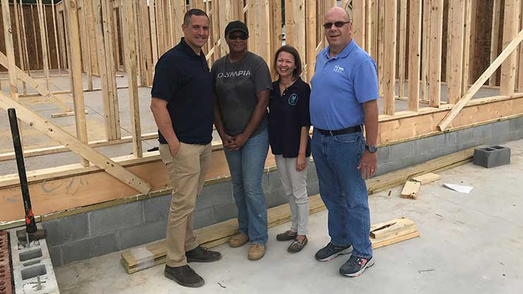 [HUD's Mid-Atlantic Regional Administrator Joe DeFelice (left) joins homeowner Michelle Hughes, Wilmington Field Office Director Maria Bynum and MHDC President and CEO David Moore for the unique National Homeownership Month Celebration]. HUD Photo
