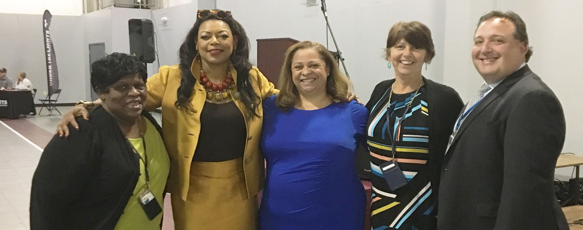 [Part of the HUD team celebrating Hollybrook Homes self-sufficiency plan. From left, Chris Griffin, Regional Administrator Denise Cleveland-Leggett, Ingrid Osborn, Yvonne Coffman and Michael Milner]. HUD Photo