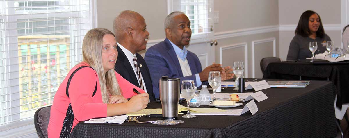 [Katie Miller of the HABG, HUD Kentucky Field Office Director Michael Browder, and HABG Executive Director Abraham Williams dialogue with partners on how best practices to help housing authority residents build self-sufficiency and resiliency]. HUD Photo