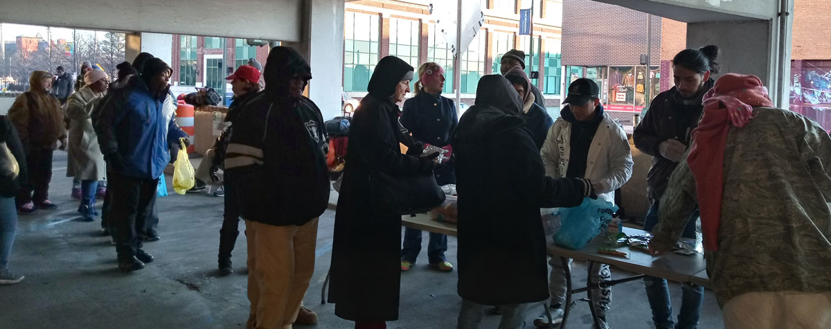 [Nearly 100 homeless individuals are being fed breakfast as part of Tiny House Community Development outreach program to help reduce homelessness and suffering].