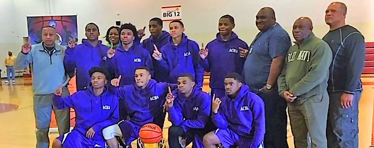 [From left, front row: JaQuerrius Hunter, Nalijah Heard, Gervantee Laney and Will Jackson. Second row, Fred Norris (coach), ZaQuavian Files, Felicia Jackson (director of competition), Aljerious Thompson, Shi Dariun Reese, Kamaure Marble, Aaron Davis, Derick Owens (coach) Clovis Townsend (coach) and Ailrick Young, Laurel Housing Authority Executive Director]. HUD Photo