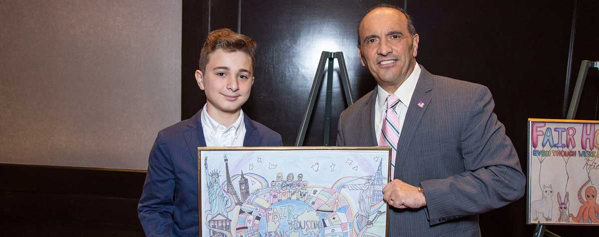 "[[Angelo Incorvaia, Grand Prize Winner with his poster ""Fair Housing Means Peace"" and Monmouth County, NJ  Freeholder Director Thomas Arnone]. HUD Photo"