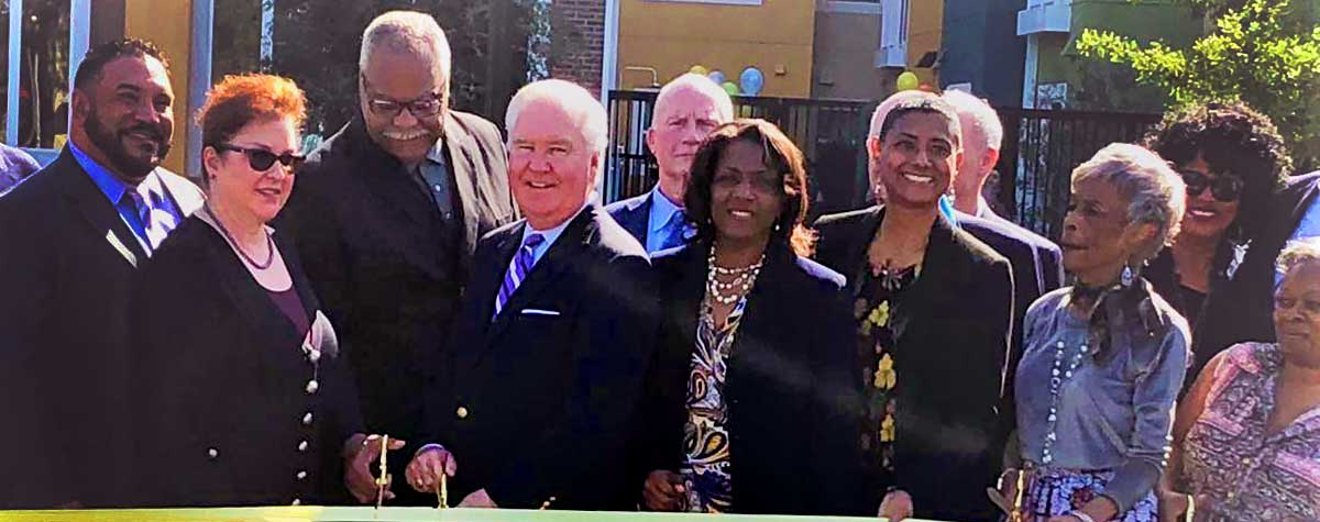 [From left: Jesse Leon, Florida Housing Finance; Eileen Pope, Bank of America CDC; Jerome Ryan, President CEO Tampa Housing Authority; Bob Buckhorn Tampa Mayor; Alesia Scott-Ford, HUD Field Office Director; Susan Johnson-Velez, Chairwoman of Board of Commissioners Tampa Housing Authority; residents]. HUD Photo