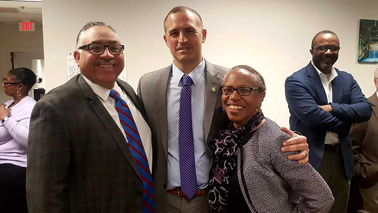 [Regional Senior Advisor Elvis Solivan, Regional Administrator Joe DeFelice and HOND Executive Director Gladys Spikes gather before the event begins.]