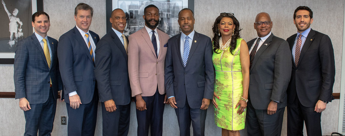 [Left to right: Coalter Baker HUD Deputy Chief of Staff, Paul Compton HUD General Counsel, Scott Turner Executive Director White House Opportunity Zone and Revitalization Council, Birmingham Mayor Randall Woodfin, Secretary Ben Carson, Denise Cleveland-Leggett, HUD SE Regional Administrator, Michael Browder HUD SE Deputy Regional Administrator and Alfonso Costas HUD Deputy Chief of Staff]. Photo Credit: OPA