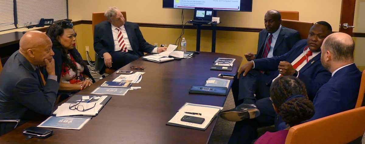 [HUD and SBA Region IV disaster leadership and staff discuss hurricane preparation measures during recent meeting in HUD Region IV Atlanta Regional Office]. HUD Photo