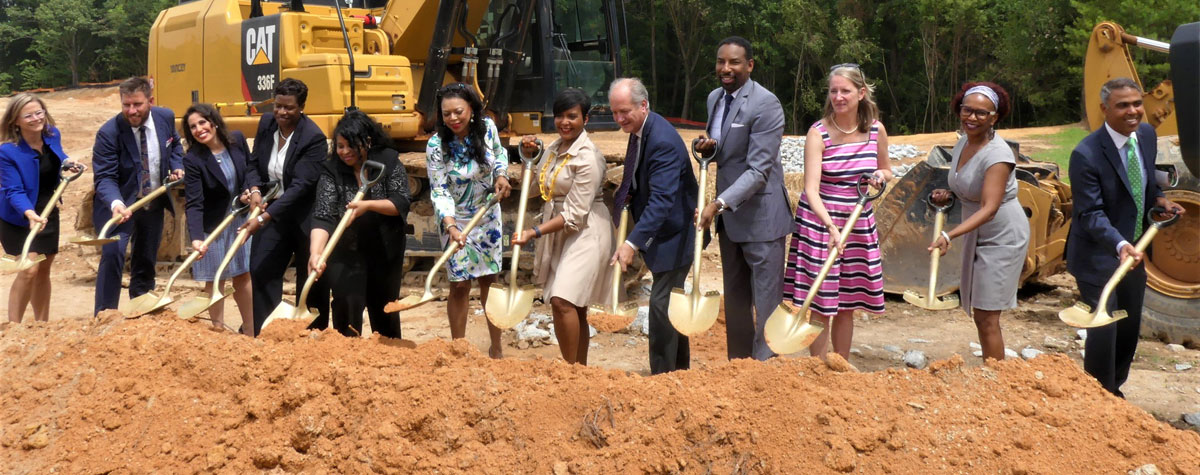 [HUD Regional Administrator Denise Cleveland-Leggett and City of Atlanta Mayor Keisha Lance Bottoms - in the center - along with community, non-profits, philanthropic, faith-based and private company leaders  break ground at the Creekside at Adamsville Place in Southwest Atlanta following the announcement of the City of Atlanta's Housing Affordability Action Plan].