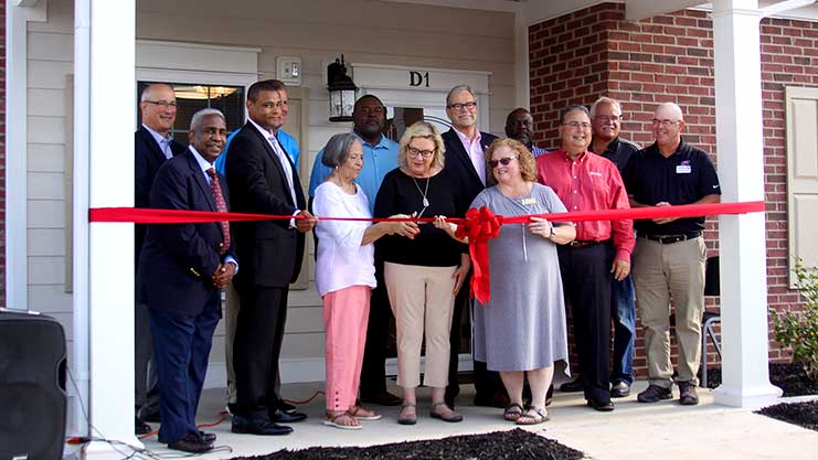 [Housing Authority of Bowling Green Executive Director Abraham Williams, HUD Kentucky Field Office Director Peter Jackson, and other partners and stakeholders cut the ribbon for Ft. Webb Manor II senior housing.]