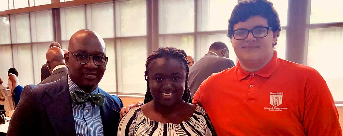 [From left, Chris Green, Bamberg Job Corps Center; students Taycerria Jackson and Joshua Browder, who shared how the program improved their lives]. HUD Photo