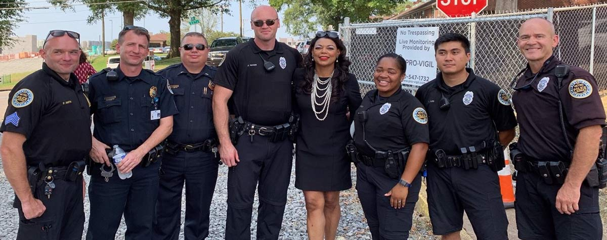 [HUD Southeast Regional Administrator Denise Cleveland-Leggett with Metropolitan Nashville law enforcement officers at Red Oak Flats groundbreaking.]