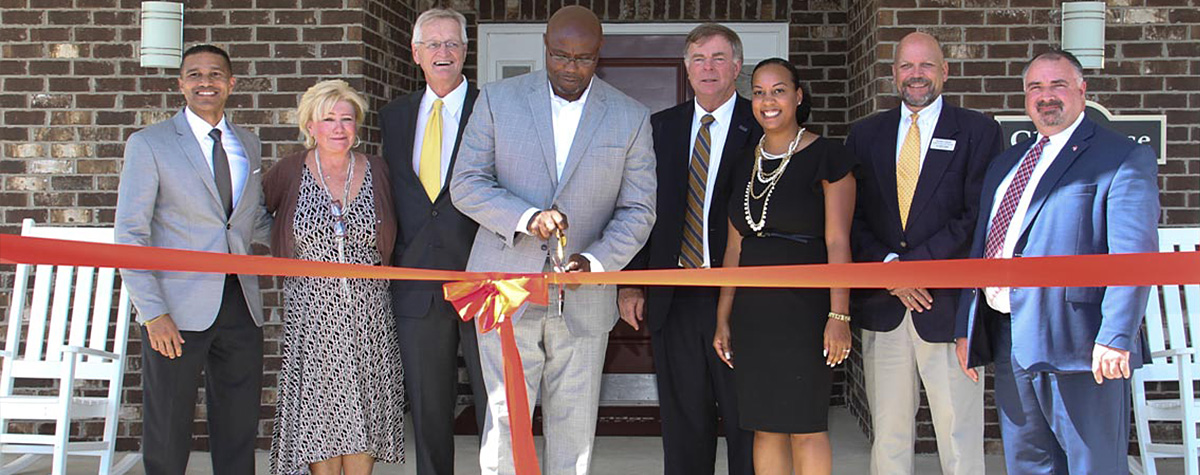 [Ken Free HUD Birmingham Field Office Director (far right) with other local dignitaries during the ribbon cutting ceremony for Stoneridge Villas].  HUD Photo