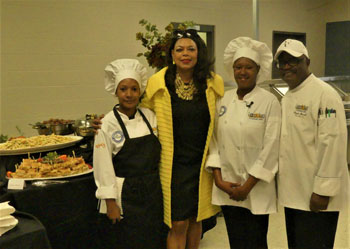 [HUD SE Region Administrator Denise Cleveland-Leggett congratulates two Campus of Hope EnVision Center Culinary Arts students along with chief instructor and mentor Chef Clayton Sherrod.]