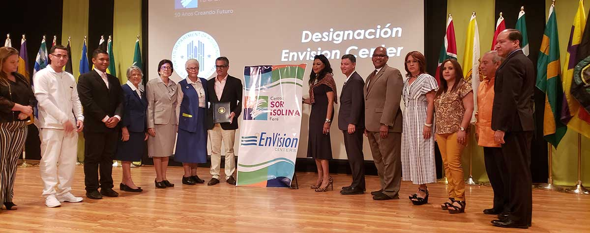 [On November 22nd, Centros Sor Isolina Ferré were designated Puerto Rico's first EnVision Center. HUD Regional Administrator Denise Cleveland-Leggett, Deputy Regional Administrator Michael Browder, Field Office Director Efraín Maldonado celebrate with the center staff and Board Members]. HUD Photo