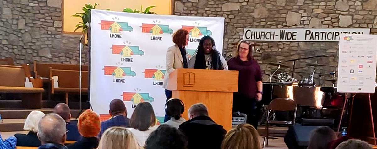 [Amy Shir, President and CEO of LHOME, welcomes Latonia Bland as a featured speaker during the LHOME Annual Celebration]. HUD Photo