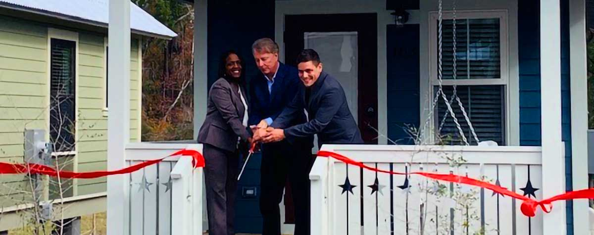 [From left, HUD Jacksonville Field Office Director Alesia Scott-Ford; Connecting Everyone with Second Chances (CESC) Board Chair Richard Kearney; and Dwellings Director Trevor Reinhardt]. HUD Photo