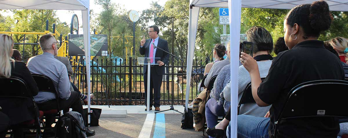 [Tampa Councilman Luis Viera welcomes the community to Harvest Hope Park]. HUD Photo