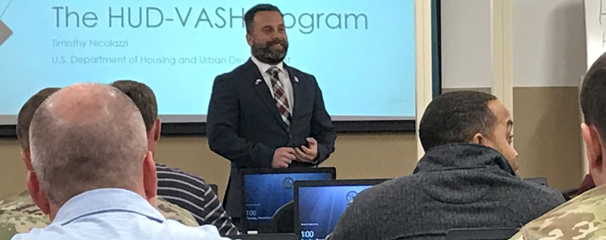 [Timothy Nicolazzi, HUD Kentucky Field Office presents information about HUD homelessness services and HUD-VASH to Soldiers transitioning out of the US Army at Fort Knox, KY.].