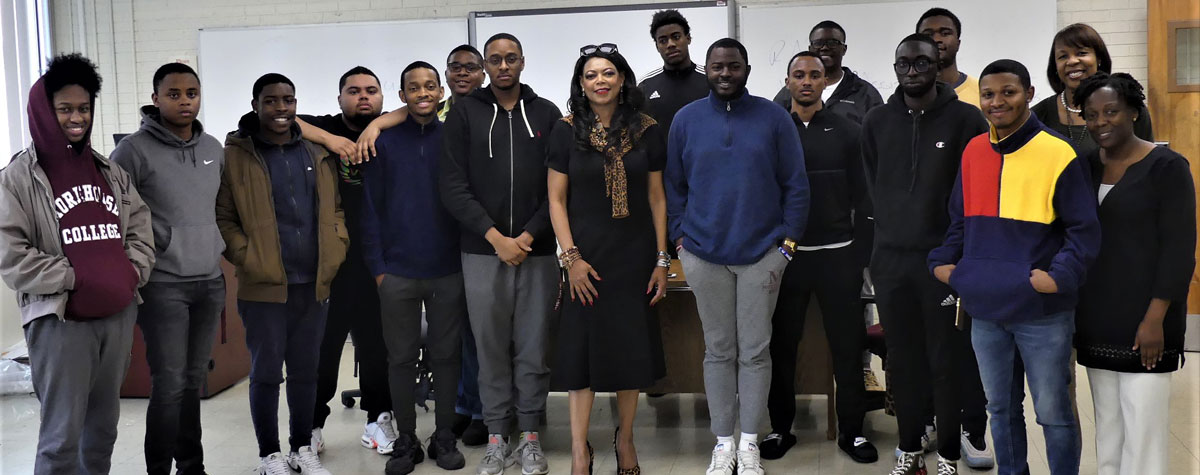 [Morehouse College students with HUD Southeast Regional Administrator Denise Cleveland-Leggett (center) along with Shea Johnson, HUD Georgia Director of Operations (back row far right) and Dr Dinead Younge, Morehouse College (far right front row)]. HUD Photo