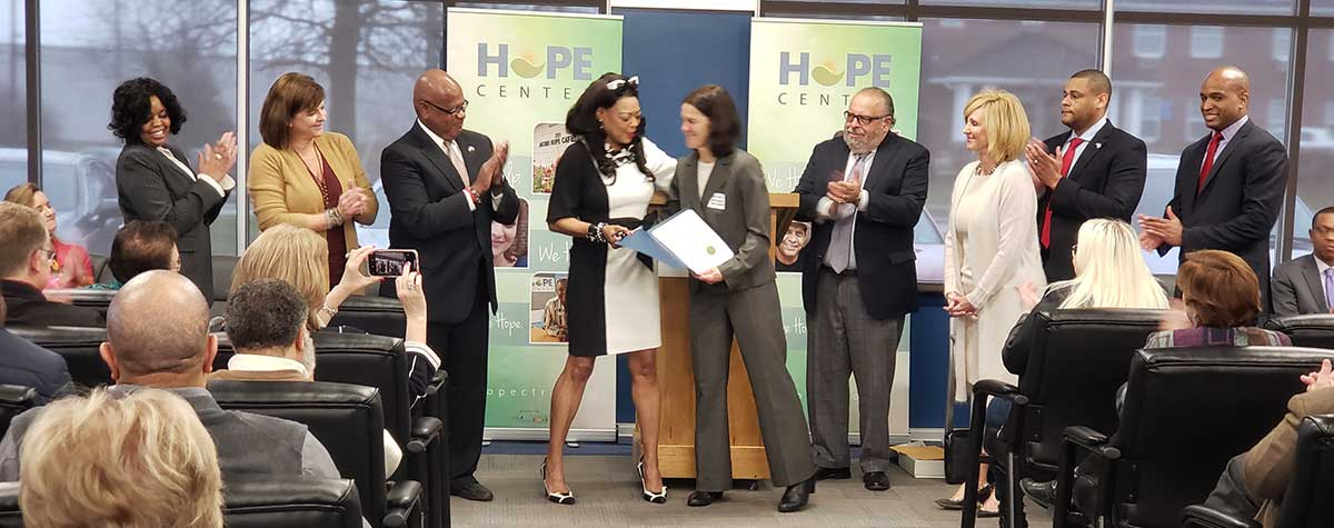 [HUD SE Regional Administrator Denise Cleveland-Leggett officially designates Hope Center an EnVision Center in Lexington, Kentucky along with Hope Center leadership, staff, local partners and HUD staff]. HUD Photo