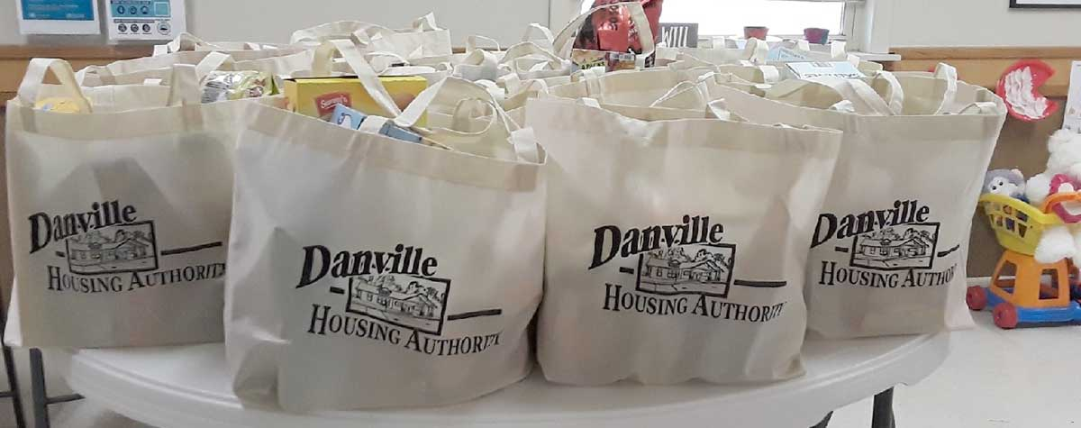 [Danville Housing Authority food essentials are readied for delivery using their new mobile food pantry van]. HUD Photo
