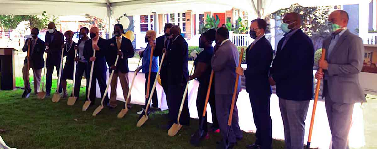 [City of Albany, Albany Housing Authority, local elected officials and partners participate in Phase 1 ground breaking celebrating HUD RAD conversion and modernization of four aging public housing residential developments].  Photo by Pennrose Development