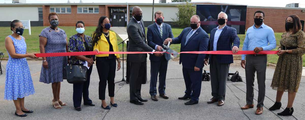 [City Huntsville, Huntsville Housing Authority and partners as well as Mr. Ken Free, HUD Alabama Field Office Director participate in the ribbon cutting ceremony of the new Huntsville EnVision Center]. HUD Photo