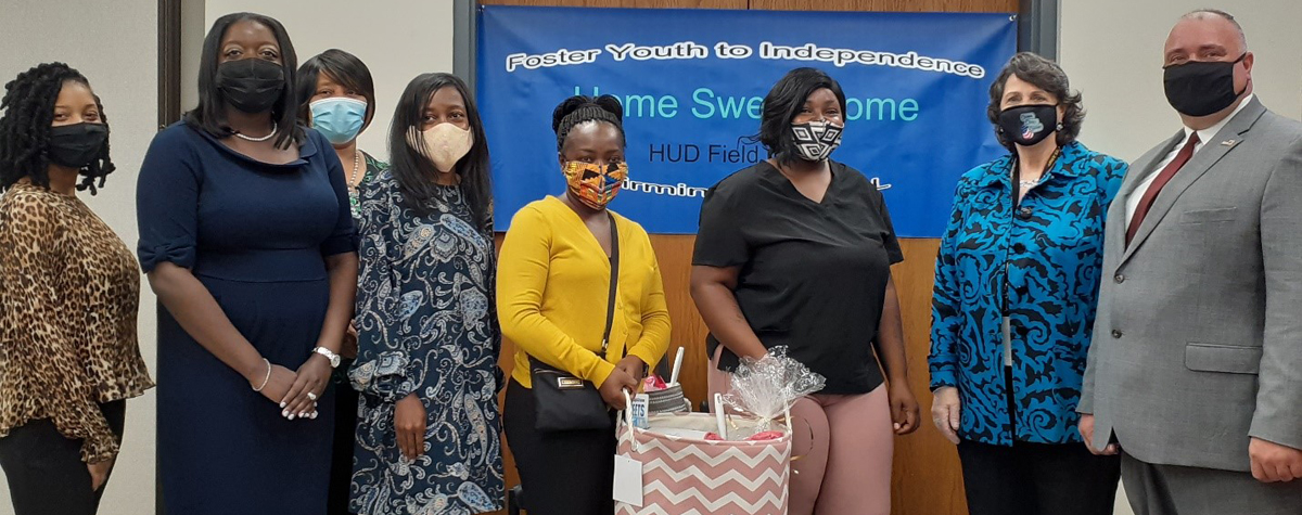 [HUD Alabama Field Office Director Ken Free & staff along with Housing Authority of Birmingham District staff presented the first FYI participant with a housewarming gift to help settle into her new place].