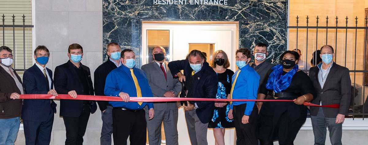 [Developer Ed Ticheli cuts the ribbon with HUD Field Office Director Ken Free (center) and LMS Real Estate Investment Management staff]. HUD Photo