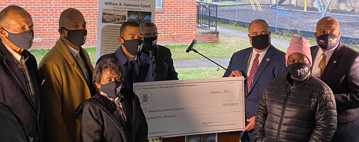 [HUD check presentation was held at Paterson Court as HUD Field Office Director Kenneth Free, Montgomery Housing Authority CEO Damon Duncan, Mayor Steven Reed, and other community members were part of the presentation].