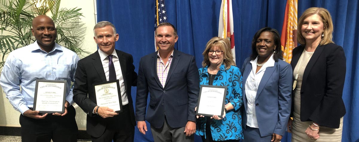 [From left, MaliVai Washington, Founder, MaliVai Washington Youth Foundation; Kevin Gay, CEO/Founder, Operation New Hope; Jacksonville Mayor Lenny Curry; Cindy Funkhouser, President and CEO, Sulzbacher Center; Alesia Scott-Ford, HUD Jacksonville Field Office Director; Dawn Lockhart, City of Jacksonville Director of Strategic Partnerships]. HUD Photo