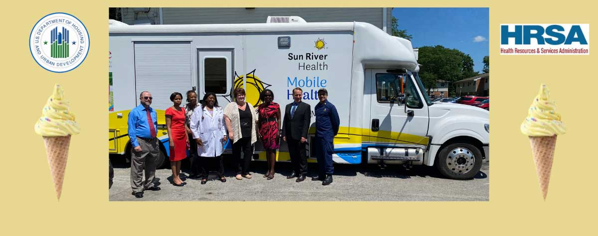 [Standing in front of Sun River Health van from left to right: Thomas Shanley, Poughkeepsie Housing Authority Accountant; Sandra Boothe, Executive Director, Poughkeepsie Housing Authority; Shirley Adams, Board Chairwoman, Poughkeepsie Housing Authority; Dr. Sonia Simpson, Sun River Health; Allison Dubois, Chief Operating Officer, Sun River Health; Cheryl Donald, HRSA Regional Administrator, U.S. Department of Health & Human Services; Stephen Murphy, Deputy Regional Administrator, U.S. Departmen]. HUD Photo