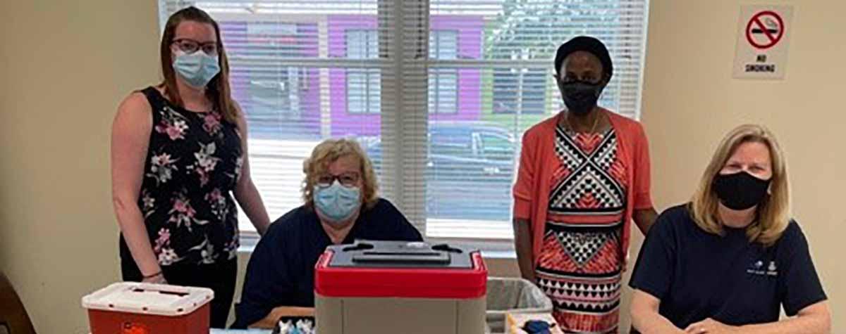 [From left, Norther Plaza site manager Kate LeBlanc; Nurse, Debra Greene; Providence Field Office Director Nancy Smith Greer; Nurse, Peg Zawryt]. HUD Photo