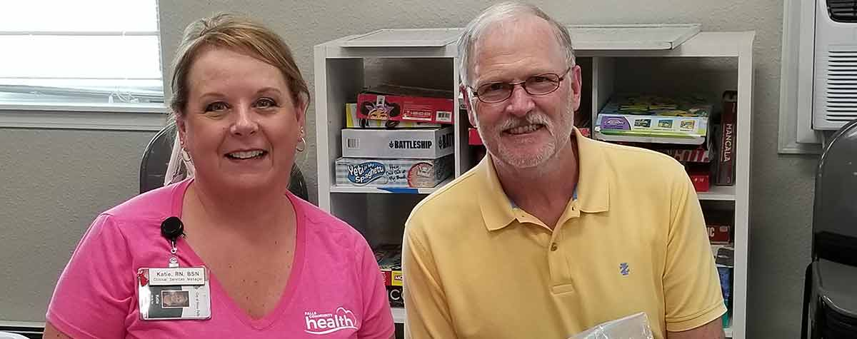 [HUD South Dakota Field Office Director and Nurse Katie, Falls Community Health greet residents at the vaccine clinic]. HUD Photo
