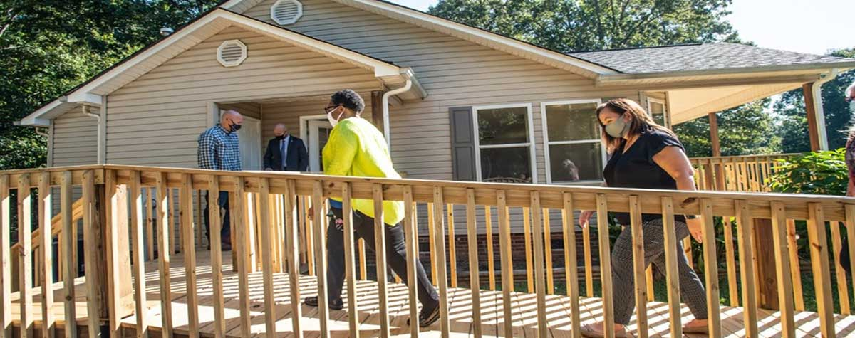 [Secretary Marcia Fudge tours a housing development in the Catawba Indian Nation Reservation in Rock Hill, South Carolina.]. HUD Photo