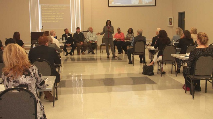 Alesia Scott-Ford, HUD Field Office Director in North Florida addresses Recovery Workshop participants. HUD Photo